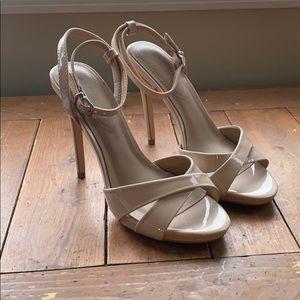 Nude spiked heel sandals.